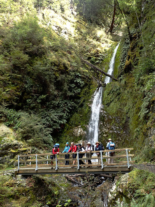 Crossing a waterfall on the Greenstone Track, NZ.